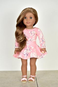 This listing includes one long sleeve croped top on the first picture of the listing Top closes with Velcro in the back. Pair it up with a skirt and any cardigan. Sold separately I make outfits for 18 dolls myself . I am not affiliated with any Doll company. The outfit is