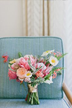 A darling mix of peonies, poppies, succulents, and protea from Megan Gray of Honey and Poppies.