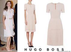 Doña Letizia debuted the BOSS 'Diblissea' pleated dress (£400.00) - a demure short-sleeve frock tailored to fit through the waist before bursting into an accordion of precise pleats at the A-line skirt. The design is completed with a slender keyhole at the neckline, and two fine shutter pleats on the front bodice. Queen Letizia of Spain attends the Presidency of the Plenary of the Spanish Royal Academy of Language 'RAE' on June 22 2017 in Madrid Spain