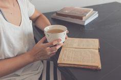 Old book and vintage mug by Seronda Estudio on Creative Market