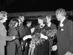 Jackie Kennedy greets Fort Worth dignitaries, trailed by Pres. John F. Kennedy as Gov. John Connally (right) watches at Carswell AFB, Fort W...