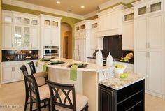 Traditional Kitchen with Glass panel, Breakfast bar, Slate, Kitchen island, Custom hood, Canyon Creek Houston Cabinetry