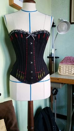 Victorian hand - embroidered  black coital corset made by me.