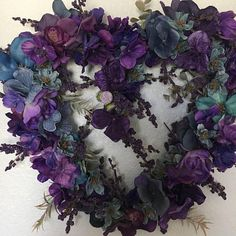 Beautiful heart shaped wreath with a multitude of purple, blue and violet flowers. Custom made. 16 X 13.5 finished size