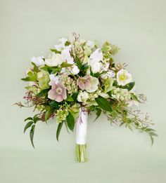 Hellebores, skimmia, tulips, sweetpea and jasmine in this Cathy Martin Flowers Bouquet