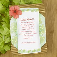 Cabin Fever  This invite has a tropical theme with a bright flower and palm leaves delicately displayed.