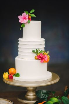 Best hibiscus cake for an elegant tropical wedding. The rest of the wedding is fabulous over at Ruffled.