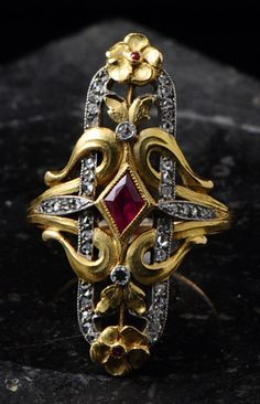 Art Nouveau Ring | Fabian Montjoye. France. Marquise ring set with a ruby