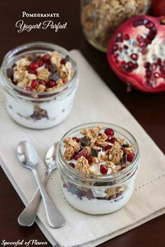 Pomegranate Yogurt Parfait - start your day with this yogut parfait. Full of granola clusters, juicy pomegranate and chocolate chunks!