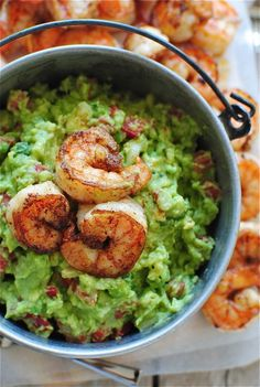 Cajun Shrimp Guacamole:  (from Absolutely Avocados)  What it took for 1 person. Just kidding! 1 stingy person:  (fine, 4):  * 4 Tbs. butter * 1 Tbs. Cajun seasoning * 1 pound medium (or extra-large!) shrimp, peeled and deveined * 3 Hass avocados * 1/2 cup chopped red bell pepper * 1/2 cup thinly sliced scallions * 1/4 cup chopped yellow onion * zest of 1 lemon * 1 Tbs (or more to your liking) fresh lemon juice * coarse salt and freshly ground pepper