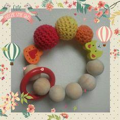 Sonajero de denticion y tartas de pañales: El carrusel de los bebes, visitanos en facebook