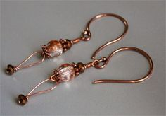 Handmade Copper and Orange Crackle Glass Earrings, Orangeand Copper Dangles Womans Gift for Her, Oneof a KindJewelry Gift, Crackle Glass Earrings, Bright Copper Earrings   These stunning two toned crackle beads are paired with beautiful copper colored tiny Czech crystals. Finished with copper daisy spacers and artisan made copper shepherds hooks. These handmade by me lovelies are one of a kind and will not be exactly duplicated. Perfect gift for that one of a kind lady on your gift list…