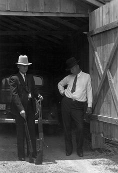 Texas Ranger, Frank Hamer (right) was responsible for traacking down and killing Bonnie & Clyde in 1934.  Here he is with their captured guns.