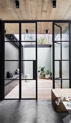 Internal courtyards flood narrow homes with natural sunlight while the surrounding walls of the building seal out city noise and create a private retreat away from the pr. Steel Frame Doors, Steel Frame House, Internal Courtyard, Small Courtyards, Backyard Garden Design, Terrace Design, Australian Homes, Door Design, Windows And Doors