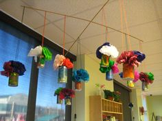 Recycled Material: Tin Cans  Hanging flower pots :)