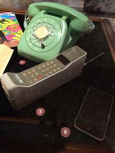 A desk phone, an early cell phone and an iphone in the Change: 125 Years Through the Eyes of Bishop Museum exhibit. http://www.bishopmuseum.org/exhibits/index.html