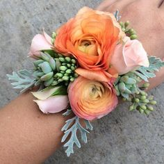 Ranunculus Mix Corsage by Flower Carriage By Ms. Cardel Send the Ranunculus Mix Corsage bouquet of flowers from Flower Carriage By Ms. Cardel in Santa Maria, CA. Local fresh flower delivery directly from the florist and never in a box! Prom Corsage And Boutonniere, Bridesmaid Corsage, Boutonnieres, Floral Bridesmaids, Wrist Corsage Wedding, Ranunculus Boutonniere, Deco Floral, Arte Floral, Mother Of The Bride Flowers