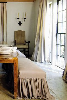 A Wonderful Skirted Bench And Linen Draperies.