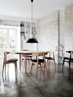 Concrete Floors + Worn Brick Wall - Everything beautiful.