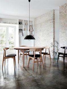Concrete Floors + Worn Brick Wall