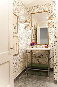 Love the gold dotted wallpaper.  Wonder if you could do this yourself using a gold sharpie?