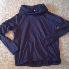 Lulu pullover black Black, cross your heart pullover.  EUC, no snags, pilling, holes, stains.  Thumbholes.  Neck is like a loose turtleneck but split in the middle.  Really cute on. lululemon athletica Tops