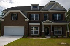 Traditional brick home by Essex Homes in Lake Carolina.  http://www.lakecarolina.com/details.aspx?hid=978#