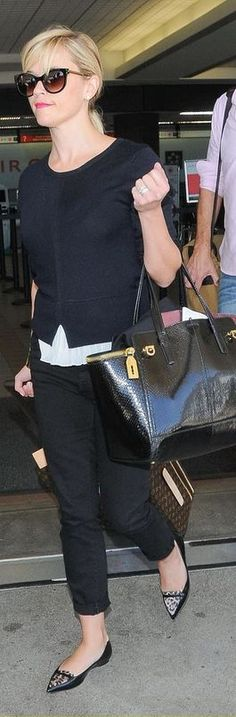 Reese Witherspoon: Purse – Salvatore Ferragamo  Sunglasses – Thierry Lasry  Suitcase = Louis Vuitton  shoes – Tabitha Simmons