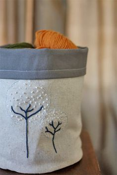 Darling material storage containers and decorative totes for gift giving.