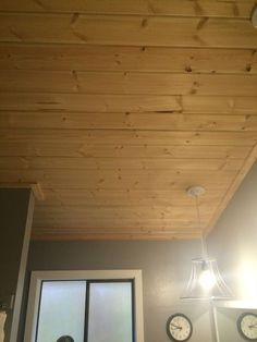 Pine tongue and groove porch ceiling in a dusty gray stain for Box car siding ceiling