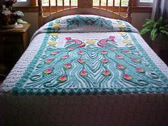 Great peacock chenille bedspread from 50's- aqua peacocks , pink , yellow on white background 90X103 inches. $239.00, via Etsy.