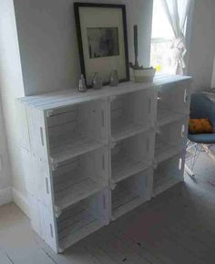 Crate media center maybe? Hang the tv above and stain instead of white? Good storage space for movies and games.