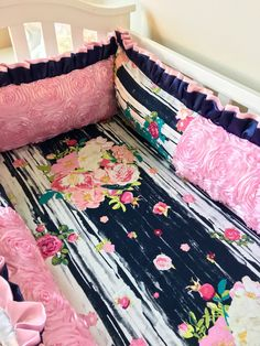Ritzy Baby Designs, LLC - Navy and Pink Floral Crib Bumper, $330.00 (http://www.ritzybaby.com/navy-and-pink-floral-crib-bumper/)