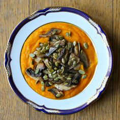 Carrot, ginger & coconut soup with sautéed mushrooms & toasted pumpkin seeds