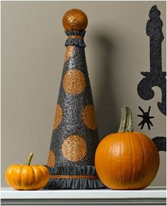 Sparkling polka dot Halloween topiary using foam cone and Krylon Glitter Blast glitter paint in Starry Night and Orange Burst