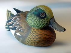 Colorful duck decoy with a green head.