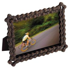 "Recycled bicycle chain makes a unique picture frame. It comes in the natural dark brown color and has  metal edging for decorations. This is not just for the cyclists and recyclists in your life. Show your love for our planet as much as your love the person in the picture frame.   Handmade in India Dimensions: 5 in. X 7 in. (holds a 4"" x 6"" photo)  With every product you purchase, you are helping provide employment, educational opportunities and medical care to artisans in India."