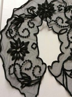 Floral net collar embellished with beading