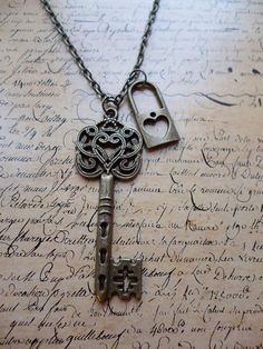 Vintage Bronze Alice in Wonderland Lock and Key Heart Bronze Necklace... This would make a pretty tattoo
