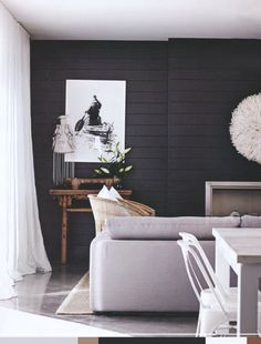 striking - white juju agains dark paneled wall. pin palette | for the love of design