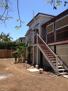 New balustrading, tilting lattice panels and under house slatting in place