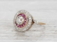 Late Victorian ring made in silver on gold centered with an approximately .80 carat EGL certified old European cut diamond with H-I color and VS2 clarity. Accented by rubies and old European diamonds.