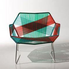 Cadeira lindona assinada pela badalada designer Patrícia Urquiola.