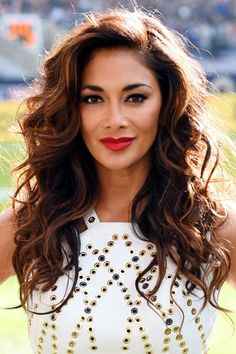 Er, just how does Nicole Scherzinger manage to get that amount of volume in her hair? It's major!