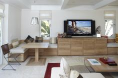 Family room in the Bahamas with custom designed cabinetry and banquette table