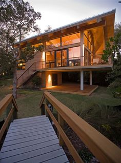 Casey Key Guest House by TOTeMS Architecture. I love the windows, the curves, and the coziness.