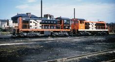 New Haven Railroad DEY-3 Alco S-1 switchers # 0993 & # 0995, are seen spotted on a track in an unknown railroad yard (most likely at Providence, Rhode Island), late 1950's, Mac Seabree Collection
