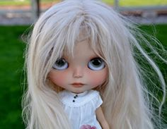 my customers blythe doll with light blonde suri alpaca hair 14 inches.