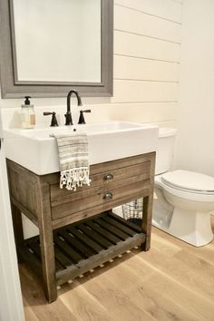 Famrhouse Bathroom. Our guest bathroom on the main level is definitely has some rustic, farmhouse charm with a shiplap wall and wood trough sink. #farmhousebathroom #farmhouse #bathroom Home Bunch\'s Beautiful Homes of Instagram Sweet Threads Design Co.