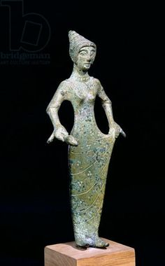 Female figure, possibly Aphrodite (bronze) | Etruscan, (6th century BC) | Louvre, Paris, France | Giraudon | The Bridgeman Art Library